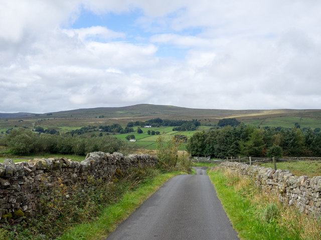Road approaching premises above east side of River South Tyne