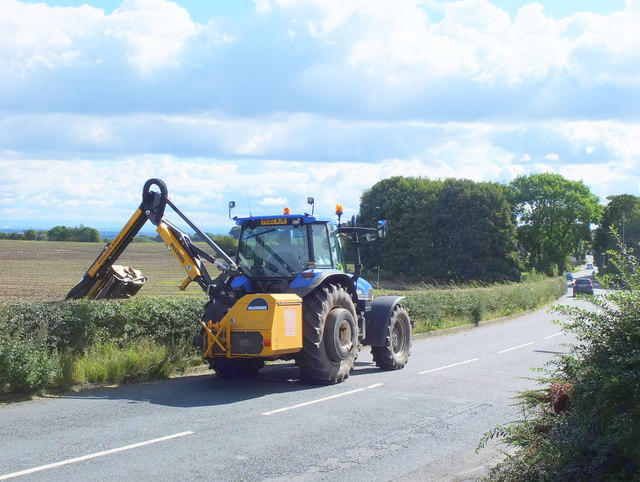 Trimming the hedgerows on Upholland Road