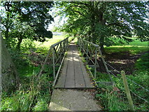 SK1133 : Footbridge over Doveridge Mill stream by Ian Calderwood