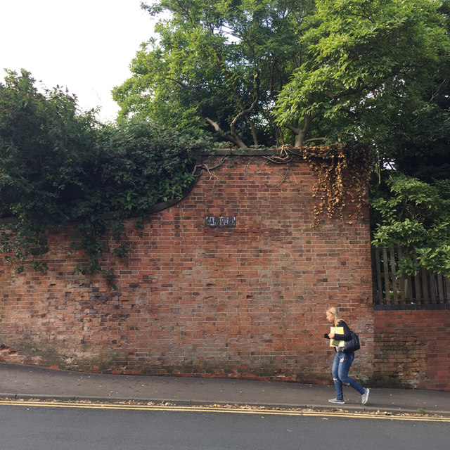 High brick boundary wall, Cape Road, Warwick