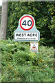 TF7714 : West Acre Village name sign on River Road by Adrian Cable
