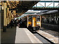 SX9193 : A well loaded train for Barnstaple at Exeter St David's station by John Lucas