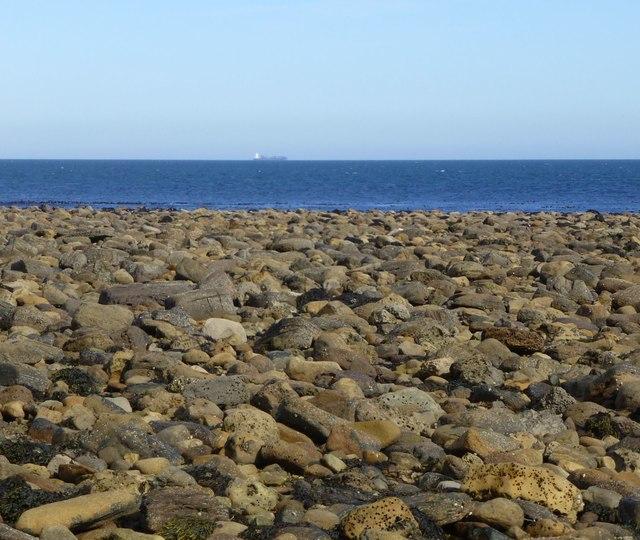 Bouldery beach east of Emmanuel Head