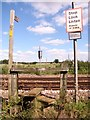 TG3405 : Stile on footpath crossing railway tracks by Evelyn Simak