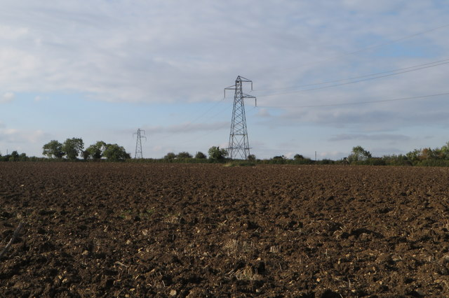 Pylons in the ploughed field