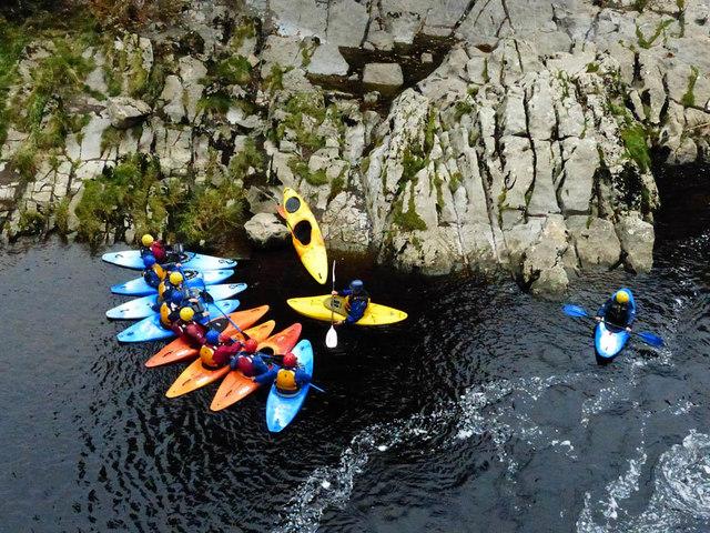 Kayakers under instruction beneath Devils Bridge