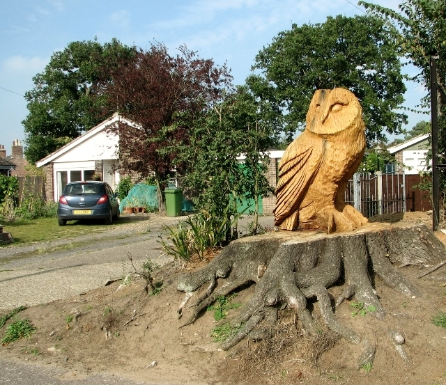 Owl sculpture by access road to houses off Church Road