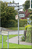 TL9165 : Signpost & Station Hill sign by Adrian Cable