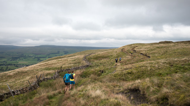 Runners in fell race crossing slopes of Wether Fell/Drumaldrace