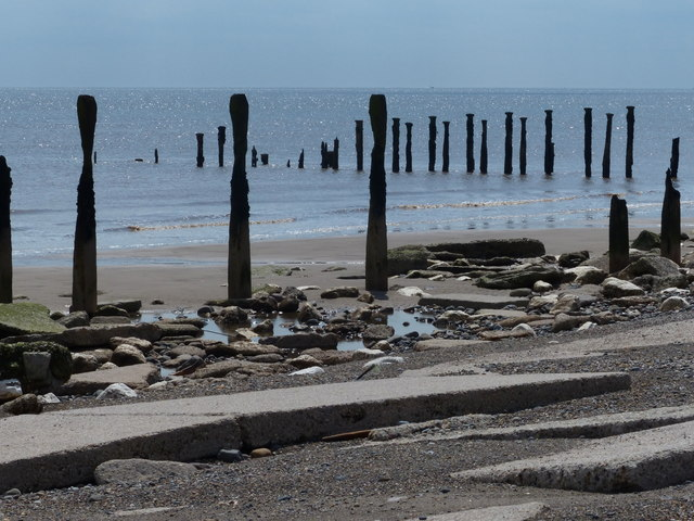 Old groynes on the beach at Spurn