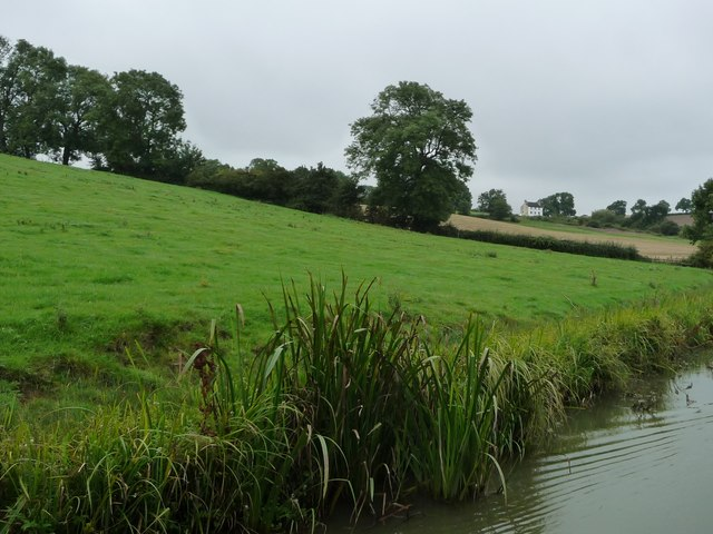 Farmland rising above [south of] the Grand Union Canal