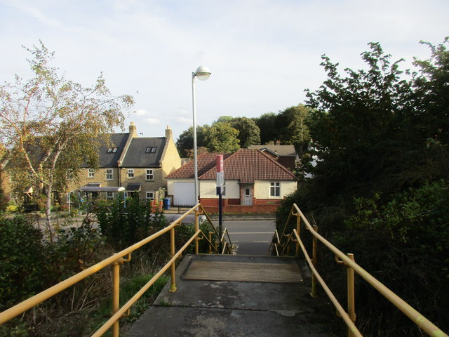 Steps down from the station