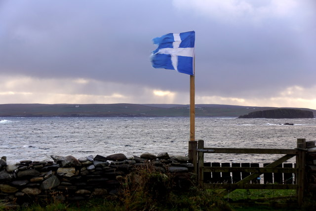 Shetland flag outside the cottage at Westing beach