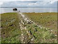 TQ6975 : Remains of the jetty to an old lighthouse on Higham Saltings by Marathon
