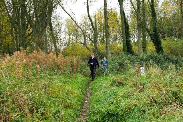 Walkers approaching along footpath