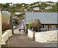 SW7214 : Looking down New Road past the harbour entrance (on the left), Cadgwith by Derek Voller