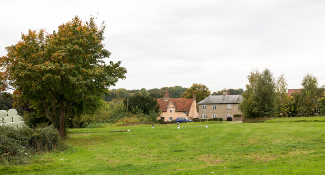 Grassed area in Hawkedon with houses beyond