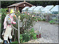 SP8509 : A scarecrow and Greenhouses at Lindengate by Chris Reynolds