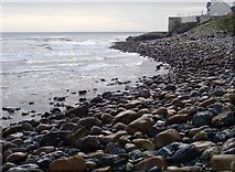 J3730 : Sea smoothed stones between the Glen River estuary and the WWII Pillbox by Eric Jones