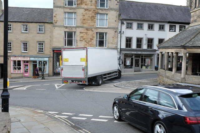 Traffic round the Butter Cross