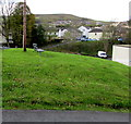 SS9991 : Bench in a grass triangle, Penygraig  by Jaggery