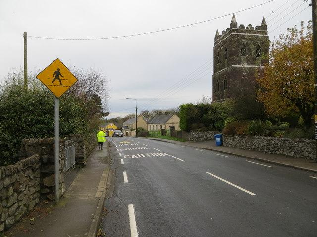 Main Street (R513) in Ballylanders near its derelict church