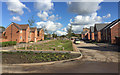 SP3682 : New houses and surface water channel, Bretford Road, Wood End, north Coventry  by Robin Stott