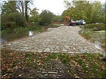 SO8843 : Restoration work on the 'water splash' by Philip Halling
