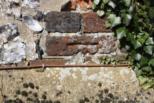 Old benchmark on The Crown beside A4130 at Nuffield
