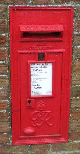 Close up, George VI postbox on Station Road, Heacham