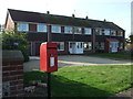 TF7944 : Elizabeth II postbox and houses on the A149, Brancaster Satithe by JThomas