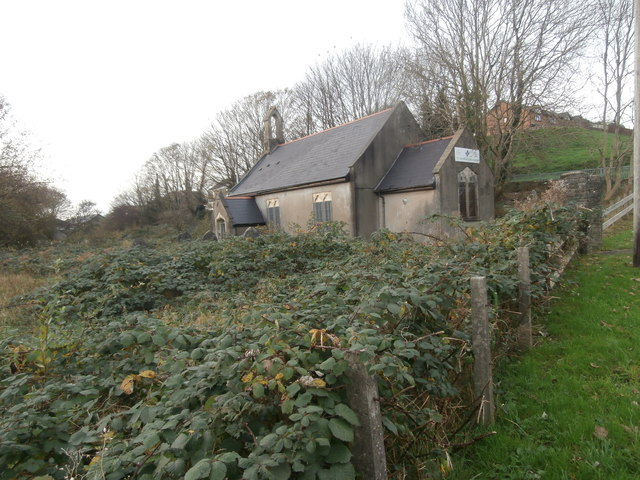 Overgrown graveyard and the former Church of St John the Baptist