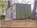 NJ6906 : Tool shed; in Midmar kirkyard by Stanley Howe