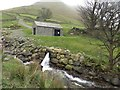 NY4112 : Hayeswater Gill Hydroelectric scheme power house and outflow by Graham Robson