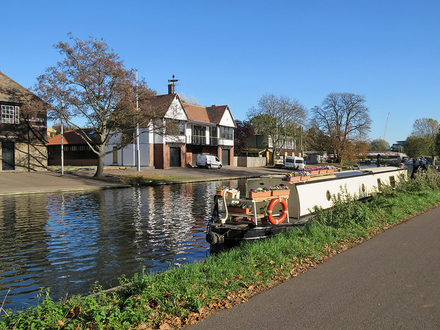 Midsummer Common: boathouses and a flowery boat