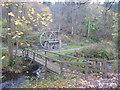 NU0701 : Northumberland Landscape : Footbridge and Waterwheel, Cragside Estate by Richard West