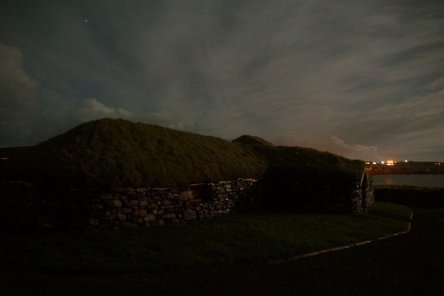 Viking longhouse at Haroldswick by moonlight