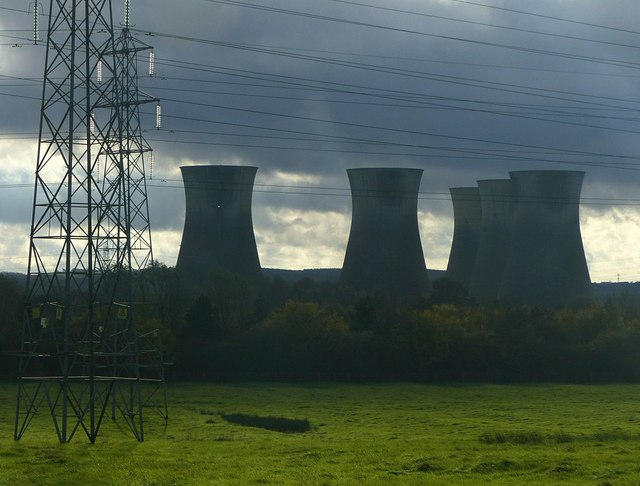 Towers, lowering clouds and pylons