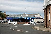 NT9953 : Tyre depot by Bill Harrison