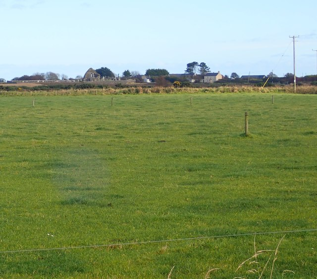View across culivated grassland towards Kilwirra Church
