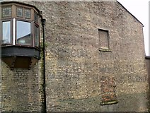 SJ9698 : Faded ghost sign by Gerald England