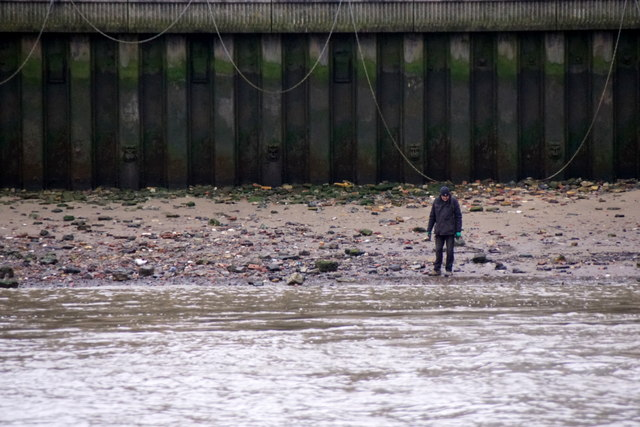 Beachcombing beside Blackfriars Bridge, London