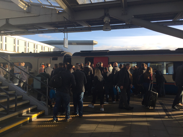 Football supporters and others boarding a train at platform 6A, Derby station