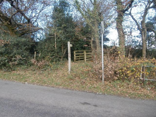 Sign and footbridge to footpath to Rhiwfelin Fach Farm