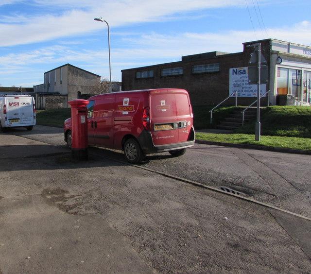 Queen Elizabeth II pillarbox and a Royal Mail van on a Bettws corner