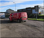 SS9086 : Queen Elizabeth II pillarbox and a Royal Mail van on a Bettws corner by Jaggery