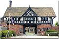 SJ3081 : Thornton Manor Gatehouse by Jeff Buck