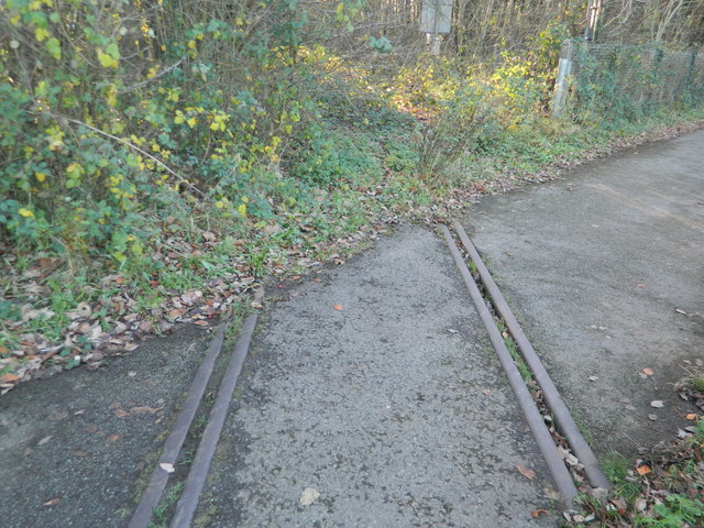 Disused railway crosses the footpath beside the A473, and disappears into the undergrowth