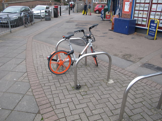 Dockless hire bike on public parking stand