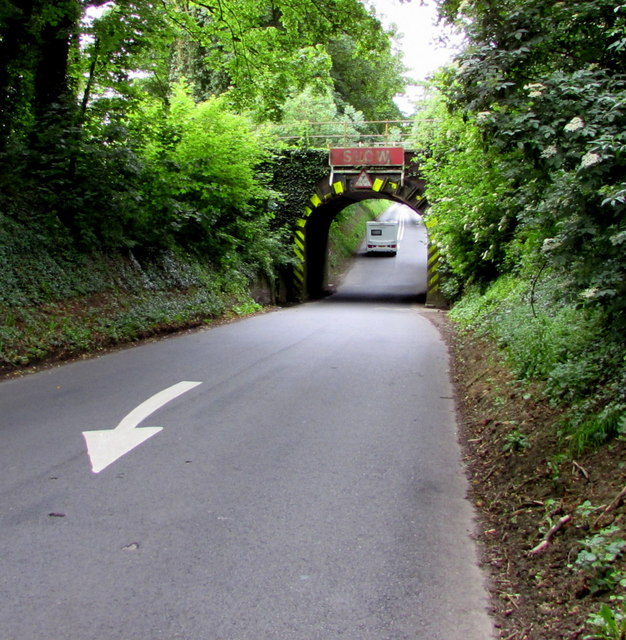 Descent towards a railway bridge near Kemble
